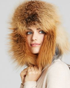 Keep cozy in a luxurious statement capper from Maximilian featuring playful ear flaps and real fox fur trim. | Nylon; real fox fur: origin: China, natural; lining: polyester | Professional fur clean |