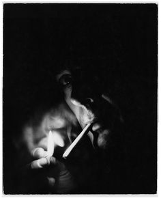 Italian actor Marcello Mastroianni smoking. © Estate of Bert Stern / Courtesy Staley-Wise Gallery, New York