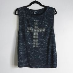 Forever 21 muscle tank Forever 21 muscle tank top with cross embellishment in front. In good condition. Size medium but can also fit large (runs a little big) black/grayish color. ❌no trades. Forever 21 Tops Tank Tops
