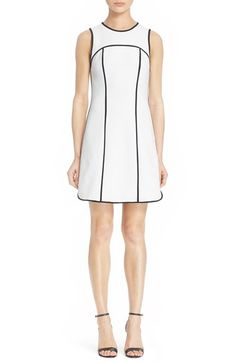 Free shipping and returns on Alice + Olivia 'Emiliee' Seamed Sheath Dress at Nordstrom.com. Black binding tracing the seams accentuates the impeccable tailoring of an effortlessly chic sheath tailored with a flattering, sleeveless silhouette.