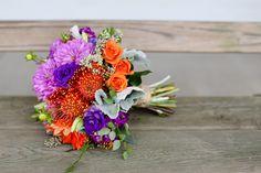 Rustic fall wedding, purple and orange flowers - pin cushion protea, purple dahlias, orange roses, seeded eucalyptus - Carley Rehberg Photography - Flowers by Jane Guerin