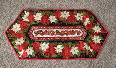 Christmas quilted table runner It is made of cotton fabric in a smoke free home Measures 15 X 21