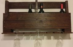 Wine bottle/wine glass rack. Hold 7-8 standard wine bottles and 6 wine glasses. Handmade from recycled pallet wood. Stained Dark Walnut.