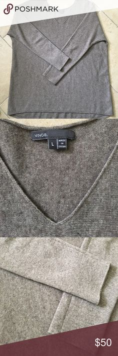 Vince. Oversized vneck sweater size L Vince. Beautiful V neck oversized sweater size L.  Wool and cashmere. Pre owned in good condition. Has one small spot on the right side of the v neck in pic. Hardly noticeable. Vince Sweaters V-Necks