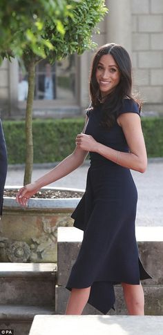 Meghan was glowing as she smiled for waiting cameras at Cliveden House Hotel on the National Trust's Cliveden Estate where she will stay the night with her mother Doria Ragland who flew over from the US on Wednesday