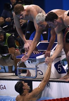 #RIO2016 USA's Michael Phelps celebrates with teammates after they won the Men's 4x200m Freestyle Relay Final during the swimming event at the Rio 2016...