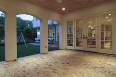 gorgeous french doors + whitewashed brick patio and ceiling