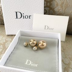 Dior Two Tone Gold Silver Tribal Earrings Tribale Gorgeous rare Dior Mis En Dior Tribale Earrings. Double ball tribal earrings are absolutely gorgeous and popular! I love these because they can be worn with gold or silver. Not sure if selling, absolutely authentic with box, dust bag and pamphlet. Excellent condition! Gold large ball with contrasting silver ball at stud. Dior Jewelry Earrings