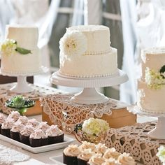 Wedding dessert display. Instead of cupcakes, surrounded by family made desserts. Looks like cakes are on top of vintage cigar boxes.