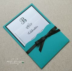 Unique Bat Mitzvah invitation with pocket to hold inserts.  Matching teal crystal highlights a beautiful initial.