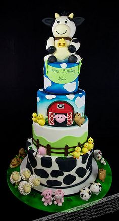 Farm theme cake--I am not sure about the huge cow on top of the cake, but the rest is really so cute!