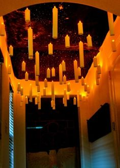 I really love this. O_O Harry Potter inspired floating candles. These were made from paper towel rolls and battery LEDs. So insanely easy! The link has TONS and tons of ideas for an entire Harry...