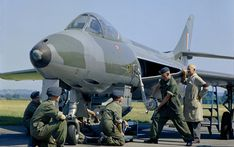 An instructor shows Aircraft Apprentices of No 1 School of Technical Training at RAF Halton, Buckinghamshire how to load a gun pack of four Aden cannon into an instructional airframe of a Hawker 'Hunter'. Airplane Fighter, Fighter Aircraft, Fighter Jets, Military Jets, Military Aircraft, War Jet, Royal Air Force, War Machine, Cold War