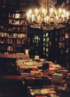 Chandelier + books = fantastically cozy.