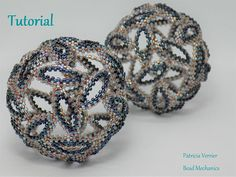 *This is a tutorial for Whirlwind, one of the first geometric shapes I designed - a beaded icosahedron made from peyote ovals that whirl around each other. It is suitable for itermediate to advanced beaders familiar with peyote stitch and herringbone increases, as well as with maintaining a consistent tension.  The finished beadwork shape will be approximately 6cm in diameter, and it requires approximately 17g of size 11 delicas.  The tutorial is 21 pages with more than 60 photographs and…
