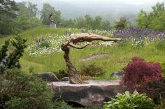 """Nestled in the Berkshires is Andrew Devries' studio. His work can only be described as """"brilliant! Unique Hotels, Wood Stone, Stone Carving, Pure Beauty, Garden Bridge, Sculpture Art, Art Gallery, Bronze, Outdoor Structures"""