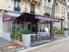 Displaying a powder-blue façade and a purple awning, L'Hydrophobe stands on the corner of rue de la Glacière and boulevard Arago. http://www.parisinsights.com/restaurants.php