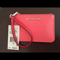 Michael kors wristlet Colorblock coral Small wristlet holds up to 3 cards is perfect for any occasion and is made of leather this would be a perfect gift for that special person Michael Kors Bags Clutches & Wristlets