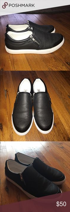 Steve Madden Black Leather Slip On Zipper Sneakers Excellent used condition. Only worn a few times. Steve Madden Elias sneakers. Rubber sides of shoes still bright white! Leather and interior in excellent condition. Slight dirt on bottom of shoes but not visible when on. Size 9. Perforated holes are not white...flash just makes them look that way...they are just indents in the black. MAKE ME AN OFFER! :) Steve Madden Shoes Sneakers