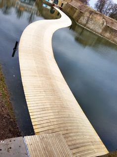 This floating wooden bridge snakes across the surface of a moat surrounding an 18th-century fortress.