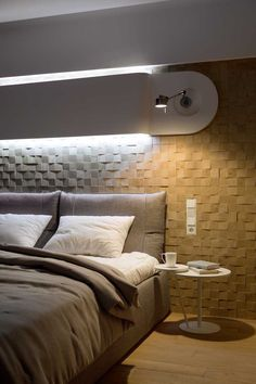 Accent Wall Ideas - 12 Different Ways To Cover Your Walls In Wood // Slightly uneven wood blocks arranged in random order add texture and coziness to this bedroom.