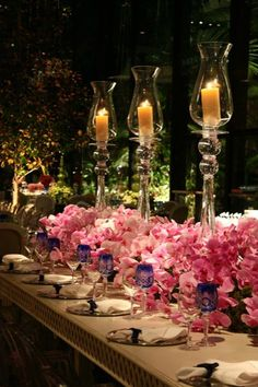 low lush florals- prefer white orchids and more integrated candles