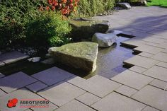 Landscaping water detail with HydraPressed Slabs by Abbotsford Concrete