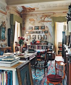Those walls....that rug..... La Maison Boheme. Love peeling walls, stacks of books, guilded frames, richly patterned rug