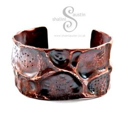 Individually hand forged copper cuff from recycled copper pipe. I use a variety of texturing and air chasing techniques to create these cuffs, each piece is organic, bold and a one off.This cuff is 6.