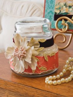 Dollar store jars are jazzed up with Mod Podge and silk flowers.