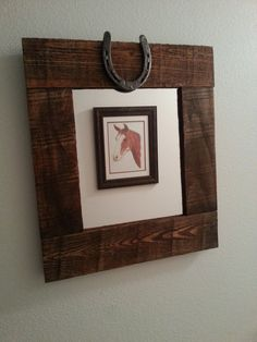 Western style mirror made from reclaimed pallet wood and a horse shoe. by DumpsterDogArt on Etsy