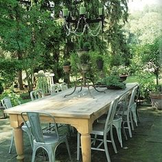 A huge table and chairs in the garden for Sunday family dinners. Twinkling lights or a chandlier are a must.