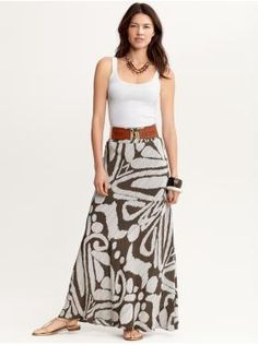 Timeless tank with printed silk maxi skirt, stretch leather tab belt, layered cabochon necklace and cool sandals.
