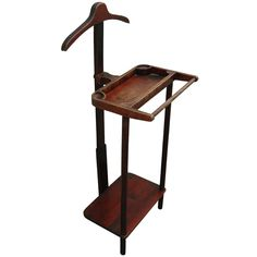 1890 Valet Stand Culture: American Medium: mahogany A vintage wooden valet stand stained in mahogany with a segmented tray with a pants bar at front and a shoe shelf below surmounted by a hanger hook. Wood Yard Art, Hanger Hooks, Suit Hangers, Home Gadgets, Wooden Diy, Diy Home Furniture, Furniture Projects, Mens Valet Stand, Hat Stands