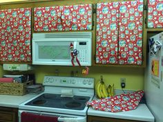 Elf on the Shelf, I'm back! Wrapped up the cupboard doors in the kitchen.