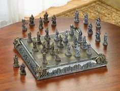 """Medieval Knights & Dragons Displayable Deluxe Chess Game Board Set by SR. $89.99. Chess Board Storage. Displayable. Medieval Style. Mystical knights and dragons square off on a medieval board, adding a legendary feel to the timeless battle of chess. All 32 finely detailed chessmen fit inside the elaborately carved chessboard case. Polyresin and wood. 17"""" square x 2 3/4"""" high."""