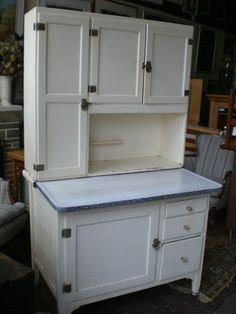 My grandmother's had a flour bin with built in sifter behind the long door.