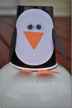 Paper cup Penguin craft  www.TheSeasonedMom.com