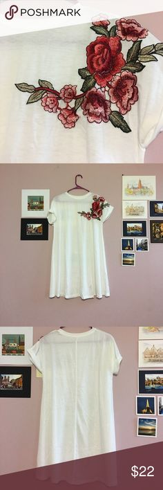 T-shirt dress with floral embroidery White t-shirt dress with floral embroidery. New without tags and only worn to try on. Size is small, but runs larger so could definitely fit a medium. Measurements are: bust is 38.78 inches, 45 inches for the waist, 33 inch length. Dresses Mini