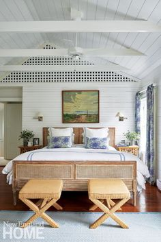 In the master bedroom, burlap-clad X benches from Safavieh flank the cane bed.