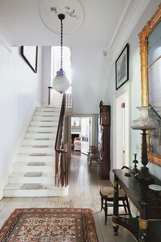 The center hallway looking toward the back of the house. The pendant lamp by Louis Comfort Tiffany came with the house.