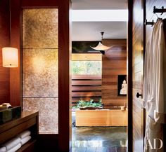 """""""We made major changes in a very subtle way,"""" explains Shadley. """"The house now has a more serene, monumental quality."""" Aniston converted one of the his-and-her baths in the master suite into a spa bath with a soaking tub."""