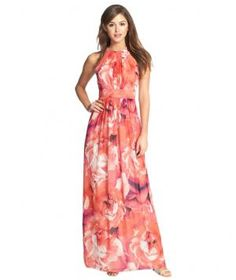 This slimming, floral-printed maxi dress perfectly echoes the romantic, laid-back mood of a beach or garden wedding. Top it off with bejeweled sandals and long dangly earrings.
