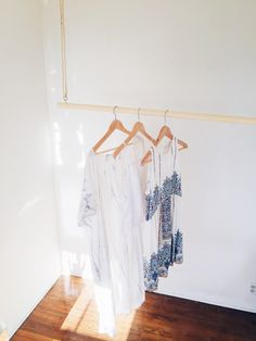 Like this: Floating Hanger Rack - Hanging Clothes Rack - Movable Clothes Line - Pine Wood Hanging Rack