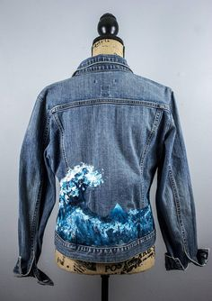 One of a kind The Great Wave of Kanagawa Inspired Art Jacket. Painted on an upcycled second hand Gap Womens Size Large Denim Jacket. 98% Cotton 2% Spandex, stretch fitted style Dimensions: Arm Length: 22 Waist: 40 Length: 22 Shoulder to shoulder:17 Hand Painted by Mandy Rypkema with