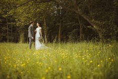 Bride & Groom's country wedding, under a tree, in a field full of flowers.