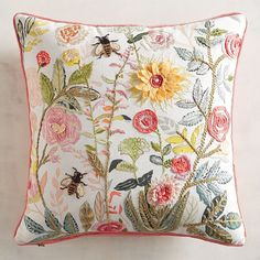This isn't your garden-variety pillow. In addition to texture and color aplenty, it features bugs and blooms. Perfect for nature lovers!