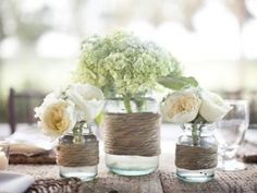 From a rustic barn wedding...jar vases wrapped in rope or twine