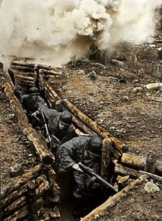 Finnish soldiers in a Trench. First soldier has a Suomi M/31 SMG with drum mag