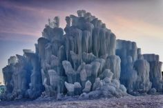Ice Castle At Steamboat Springs, Colorado Looks Like It's Out Of A Winter Storybook Land.  Massive ice castles formed by 1000s icicles. Pathways take visitors thru ice columns, tunnels, caverns, archways.